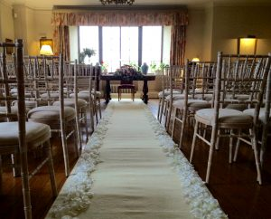 This cream aisle runner from Beau Decor with an ivory petal border was the perfect finishing touch for the wedding ceremony.